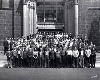 Signal Corps standing in front of entrance, Dunwoody Institute, Minneapolis, 1943.