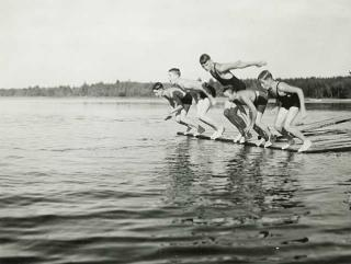 Photo: Boys diving from a raft, Eshquagama Lake, St. Louis County, 1933.