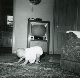 Tim Sworsky, in front of the family's television set, July 1955.