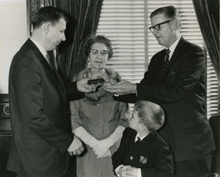 Photo: Governor Harold LeVander, presenting the All-America Goalpost Trophy to the Pearson family, 1967.