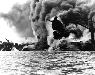 The USS Arizona, sunk and burning in Pearl Harbor, December 7, 1941.