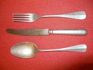Aluminum eating utensils used by Donald S. Frederick while a POW in Germany.