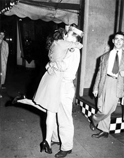 Soldier kissing a woman on VJ Day, Minneapolis, 1945.