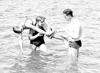 Life-saving methods demonstrated to Civilian Conservation Corps (CCC) boys, 1936.