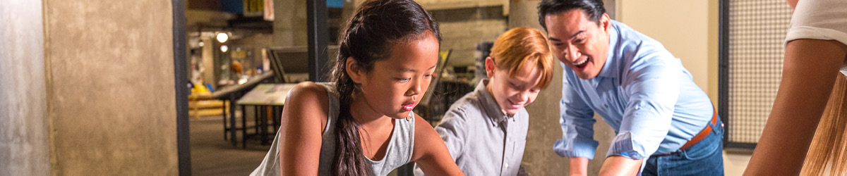 Close-up of a young girl interacting with the water lab.