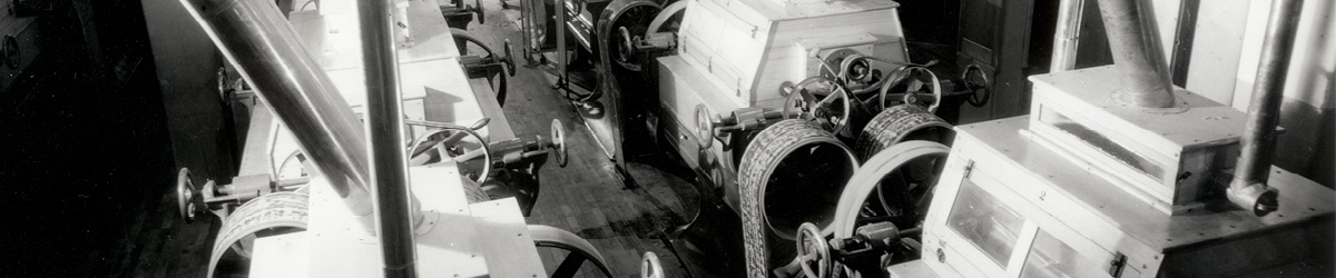 Large belts and machinery used in flour milling.
