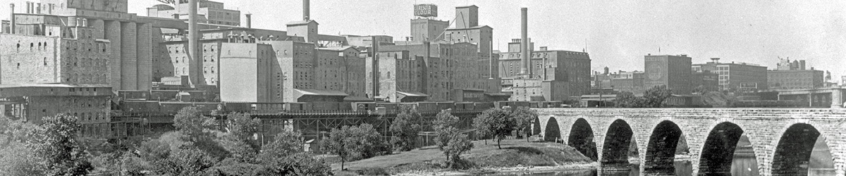 Historic photo of the stone arch bridge and view of the Minneapolis riverfront.