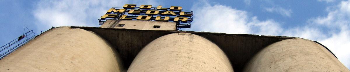 Looking up towards the large concrete grain silos.