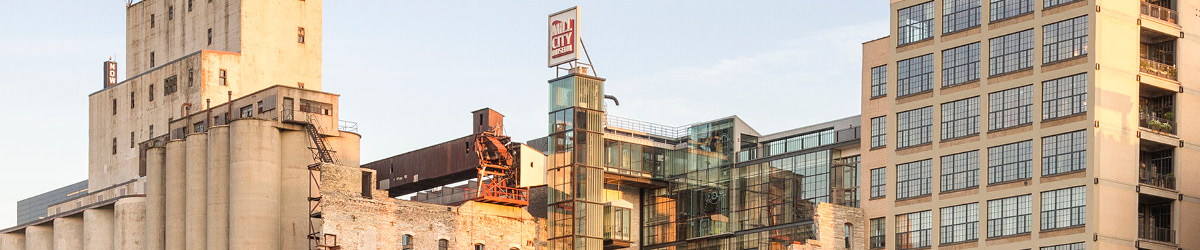 Exterior of Mill City Museum in dusk sunshine.
