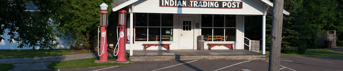 Parking lot in front of the Indian Trading Post building.