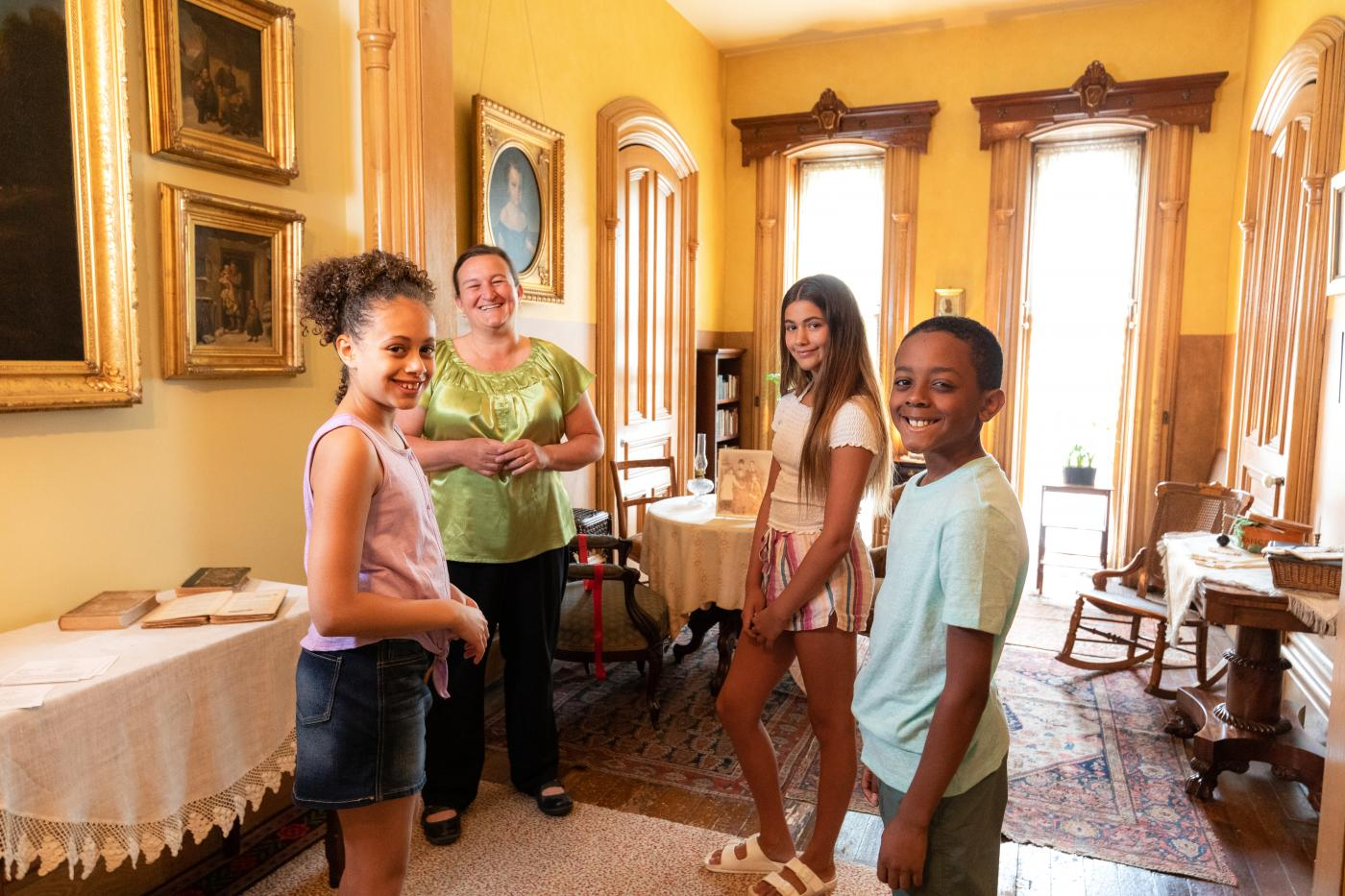 Three teenagers and a guide at Ramsey House.