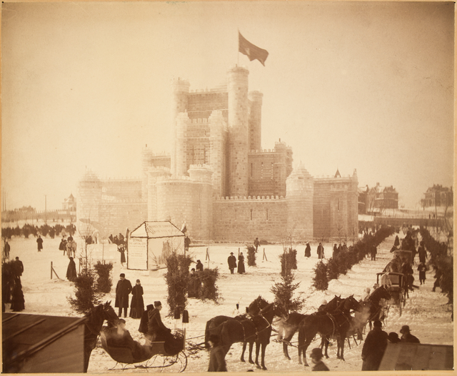 Historic photo of an ice castle with a line of horse-drawn carriages