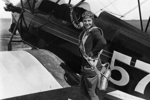 Klingensmith with one of her aircraft, a Waco biplane, ca. 1930.