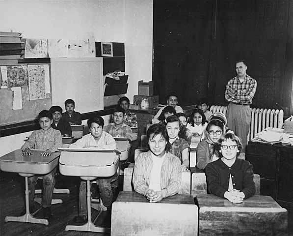 Students sitting at their desks in a classroom.