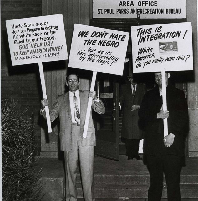 "Members of the ""Committee to End Discrimination against Fourth Class Whites"" protesting fair housing in Saint Paul on December 19, 1962."