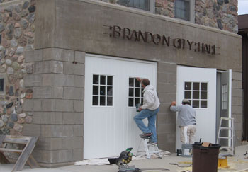 Photo: Workers restoring Brandon Auditorium doors