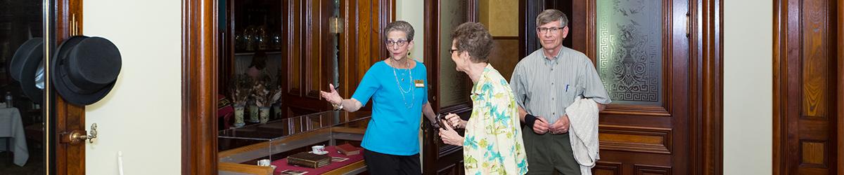 Volunteer greeting attendees at the door