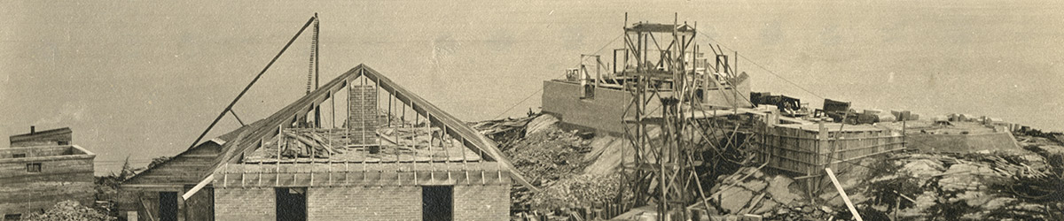 Frame of the lighthouse and two buildings under construction