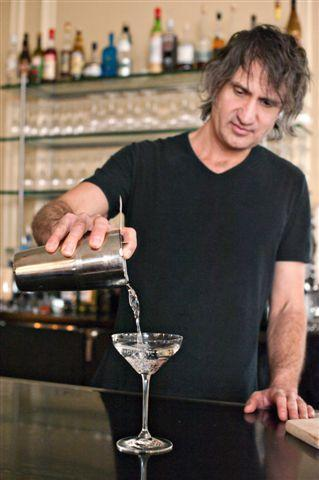 Johnny Michaels pouring a cocktail
