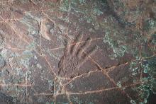 Hand print petroglyph