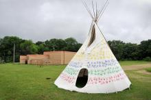 Lower Sioux Agency visitor center building and community teepee