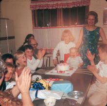 In a period when the residents of the triplex were not linked by family or ethnic bonds, their lives were still intertwined. Denny Cramer's 2nd birthday party in Cramer kitchen, 470 Hopkins, 1968  Counter clockwise: June Cramer (standing), Sheila Cramer, Denny Cramer, Krismer twin, Roland Berry, Krismer twin, Dianne Cramer, Peggy Krismer, Sandy Cramer, Evelyn Berry's hands visible, Dickie Krismer, Jr.