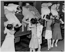 Girls say goodbye to Marine recruits at St. Paul Union Depot, 1942.