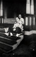Arriving from Italy at age 11, Michelina D'Aloia settled in the house in 1931 and went on to raise her own family there, staying until 1956. Russell and Michelina (D'Aloia) Frascone on the front porch of 470/472 Hopkins Street. 1943.