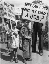 Children holding signs in a Workers Alliance picket line in St. Paul, Minn., during the Great Depression, 1937.