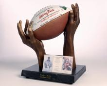 Mold of Jerry Rice's hands and a football