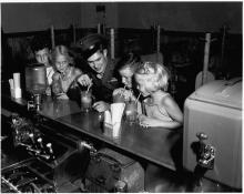 Medal of Honor winner Ricky Sorenson at the soda fountain in Anoka, after coming home from fighting in the Pacific, 1945. Look for a similar soda fountain in the exhibit.