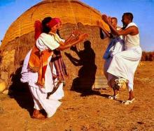 Nomads dancing in front of aqal soomaali