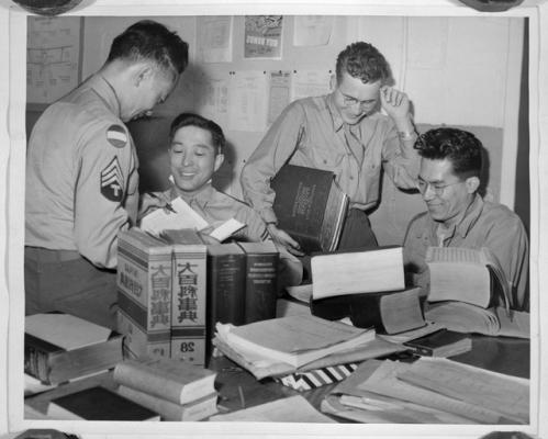 Historical photo of Japanese American men interpreting during World War II