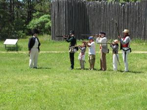 Visitors participate in musket drills